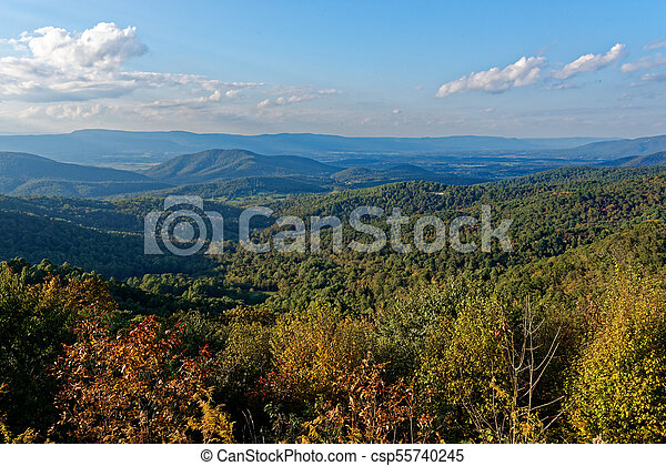 Valley with trees in fall colors - csp55740245