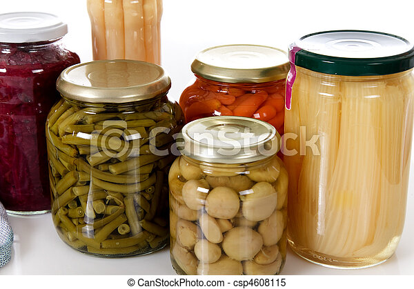 Variety of canned vegetables in jars. - csp4608115