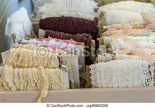 Variety of colorful lace displayed for sale at market - csp85663356