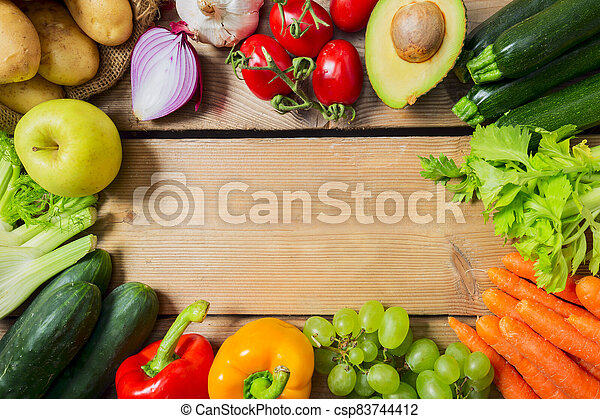 Variety of fruits and vegetables, on the wooden table, top view, copy space, selective focus - csp83744412