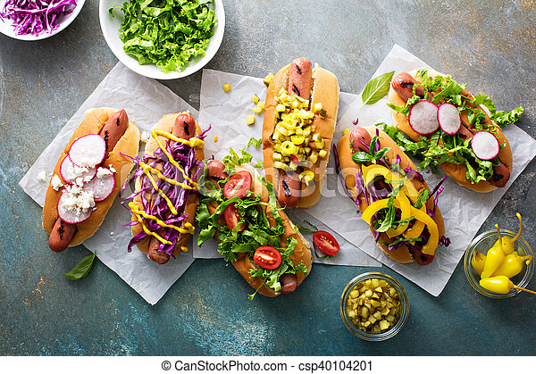 Variety of hot dogs with healthy garnishes - csp40104201