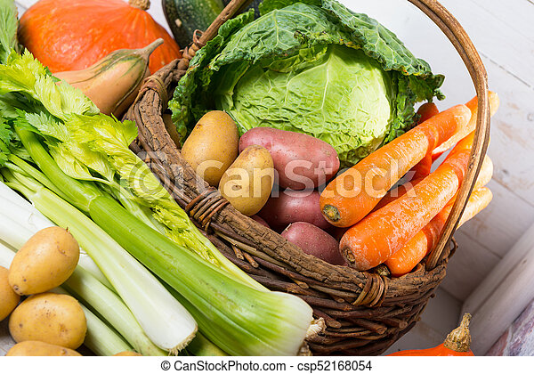 variety of raw vegetables on  the wooden table - csp52168054
