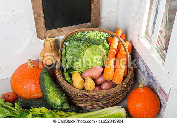 variety of raw vegetables on  the wooden table - csp52043924