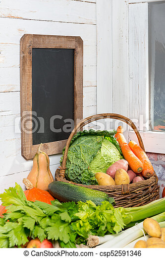 variety of raw vegetables on  the wooden table - csp52591346