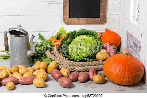 variety of raw vegetables on  the wooden table - csp52729297