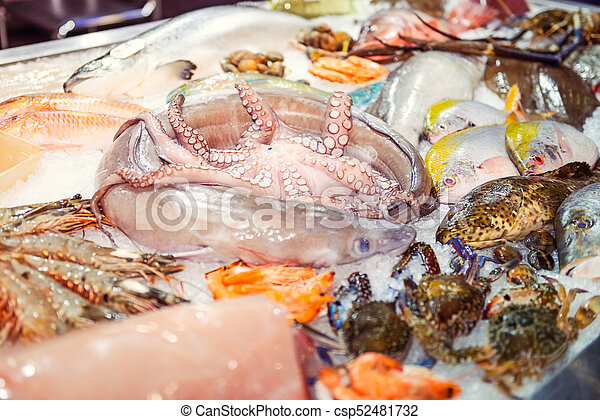 Various Exotic Seafood On The Counter Of The Fish Market Raw And Fresh Fish Octopus Crabs Shrimps In The Ice Selective Canstock