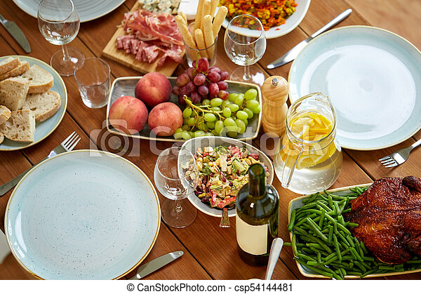 various food on served wooden table - csp54144481