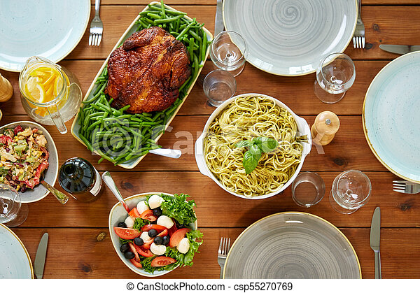 various food on served wooden table - csp55270769