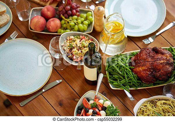 various food on served wooden table - csp55032299