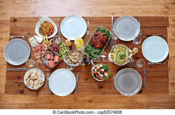 various food on served wooden table - csp53574938