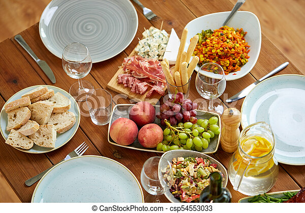 various food on served wooden table - csp54553033