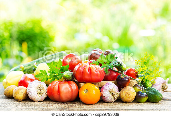 various fresh vegetables on wooden table - csp29793039