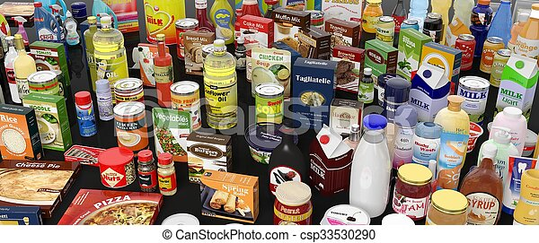 Various grocery products closeup, on black background with reflections - csp33530290