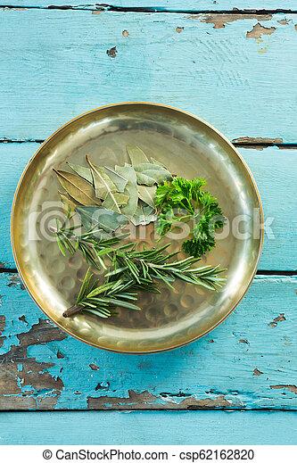 Various herbs in plate - csp62162820