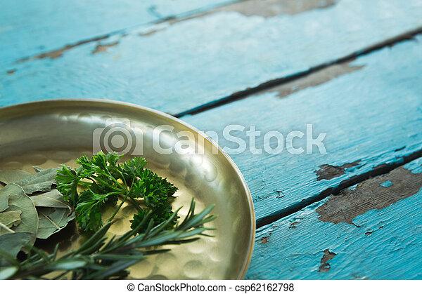 Various herbs in plate - csp62162798