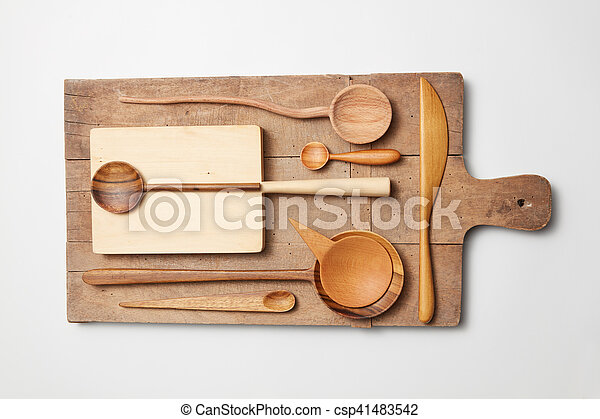 Various kitchen utensil on white wooden background - csp41483542
