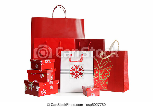Various sizes of holiday shopping bags and gift boxes on white - csp5027780