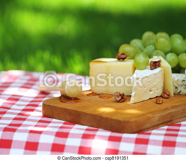 Various sorts of cheese with grapes  - csp8191351