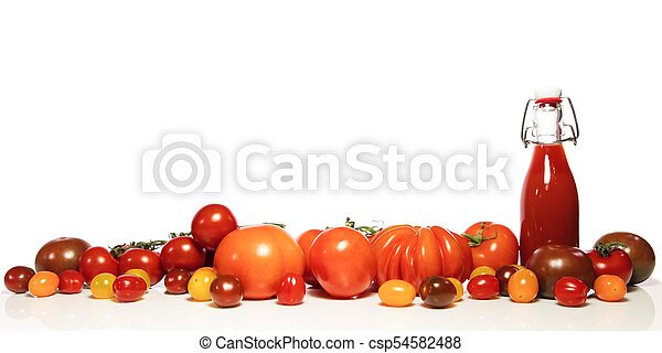 various tomatoes and bottle - csp54582488