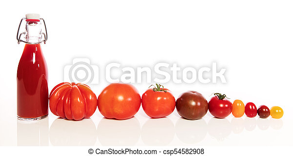 various tomatoes and bottle - csp54582908