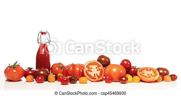 various tomatoes and bottle - csp45469930