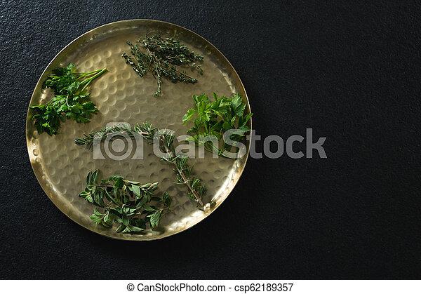 Various type of herbs in plate - csp62189357