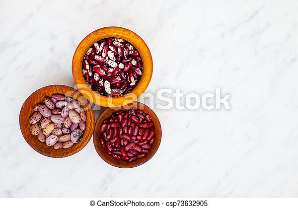 Various Types Of Kidney Beans In Wooden Bowls On A Table Three Types Of Kidney Beans In Wooden Bowls On A White Background