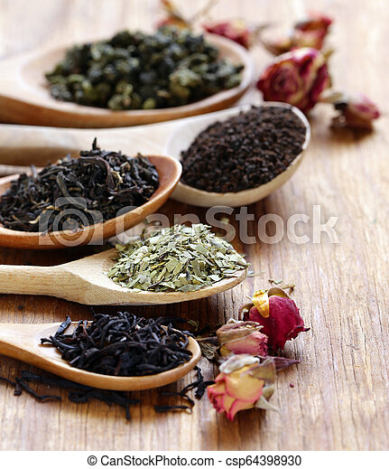 various types of tea in a wooden spoon - csp64398930