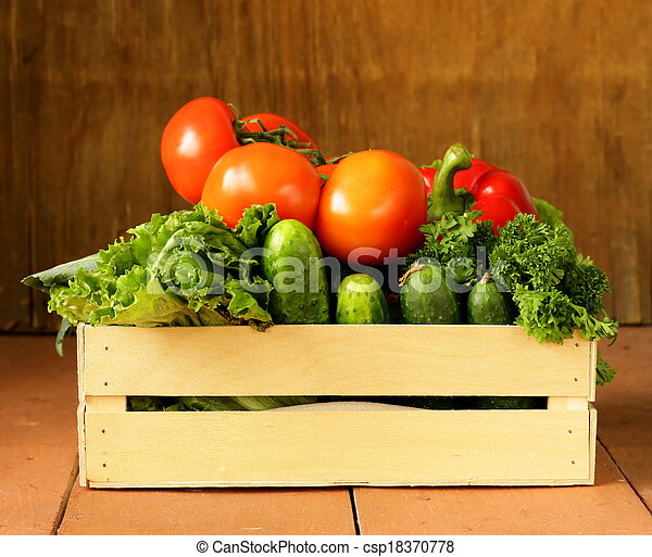 various vegetables in a wooden box - csp18370778