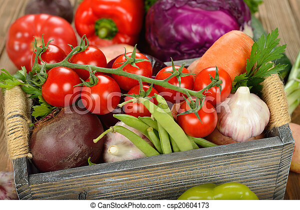 Various vegetables in a wooden box - csp20604173