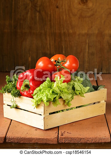 various vegetables in a wooden box  - csp18546154