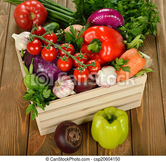 Various vegetables in a wooden box - csp20604150