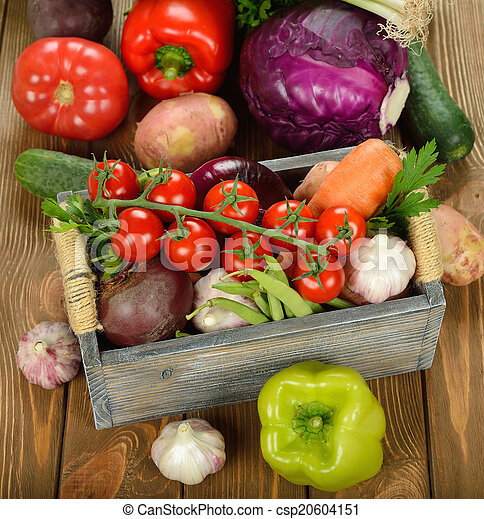 Various vegetables in a wooden box - csp20604151