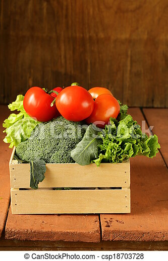 various vegetables in a wooden box - csp18703728