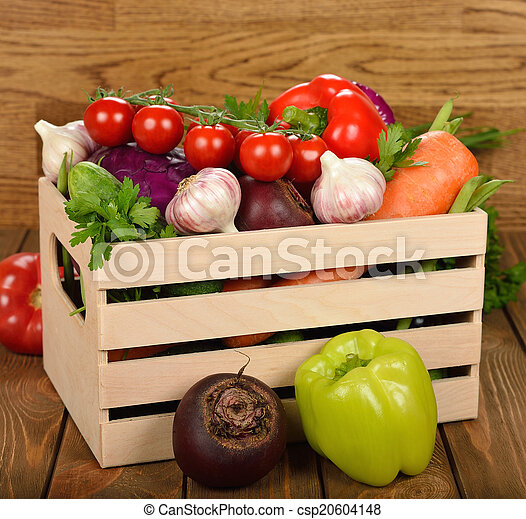 Various vegetables in a wooden box - csp20604148