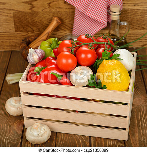 Various vegetables in a wooden box - csp21356399