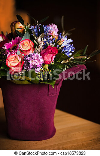 Vase like a shopping bag with spring flowers - csp18573823