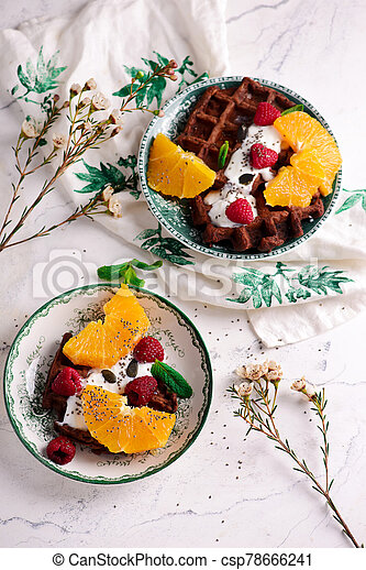 Vegan waffles with fresh fruits. selective focus. - csp78666241