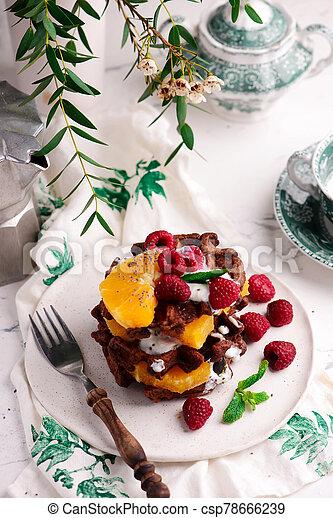 Vegan waffles with fresh fruits. selective focus. - csp78666239