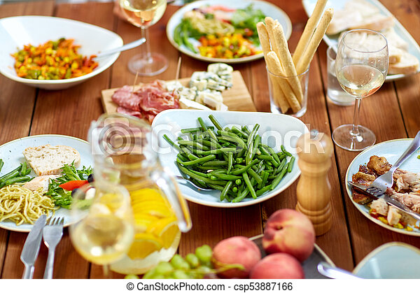 vegetable salad in bowl on wooden table - csp53887166