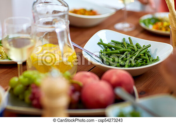 vegetable salad in bowl on wooden table - csp54273243