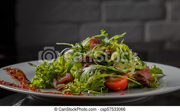 Vegetable salad on a plate on a glass background - csp57533066