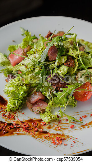 Vegetable salad on a plate on a glass background - csp57533054