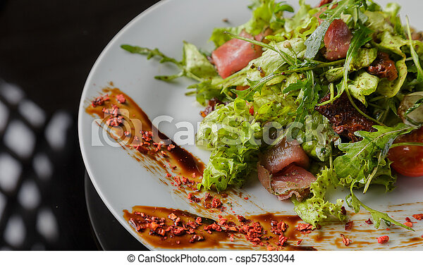 Vegetable salad on a plate on a glass background - csp57533044