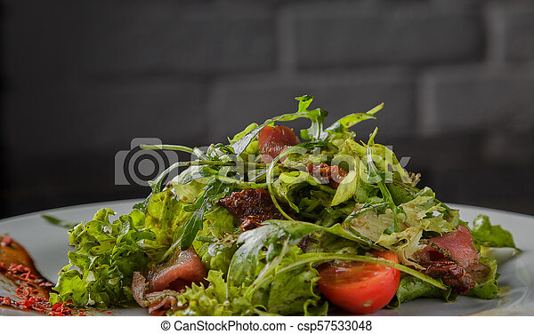 Vegetable salad on a plate on a glass background - csp57533048
