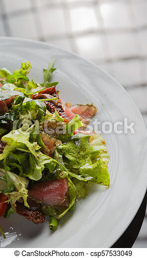 Vegetable salad on a plate on a glass background - csp57533049