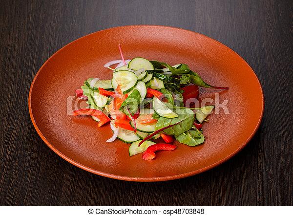 Vegetable salad on plate - csp48703848