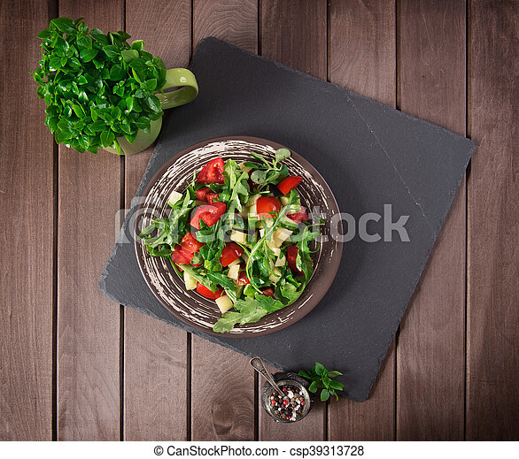 vegetable salad on wooden table. top view - csp39313728