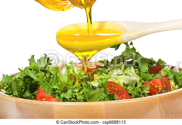 vegetable salad with olive oil pouring from a bottle - csp6688113
