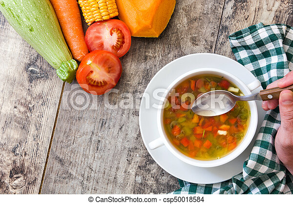 Vegetable soup in bowl on wooden table - csp50018584